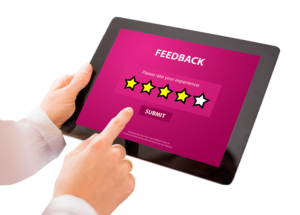 A person giving rating using an ipad
