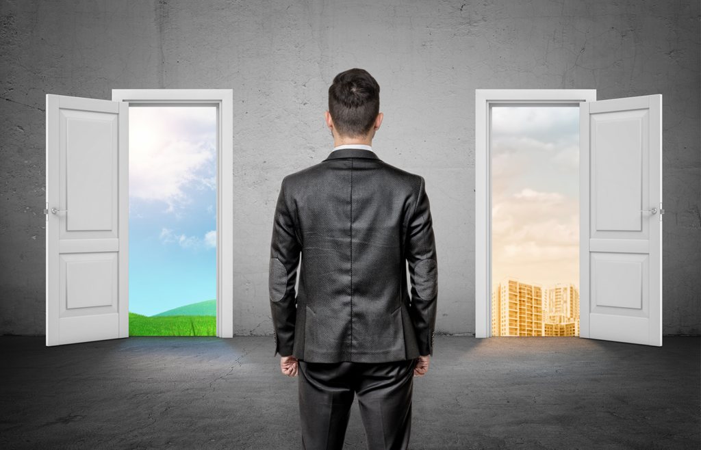 Man standing before 2 doors showing two different life paths