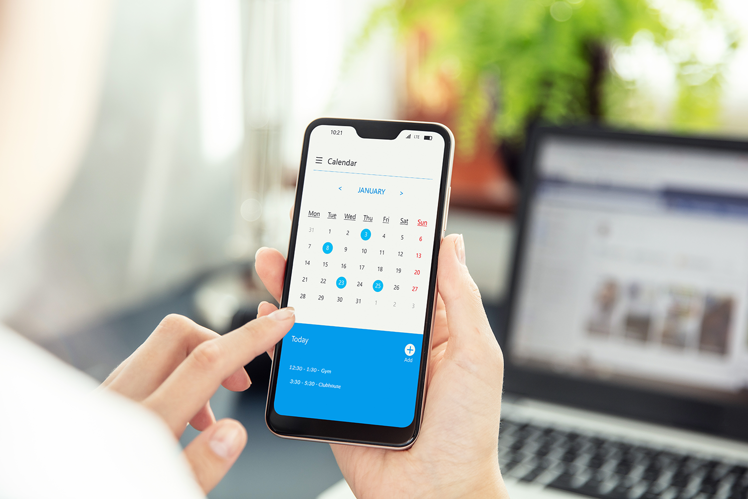 A person on their phone scheduling time to use the apartment's amenities with Respage's amenity scheduler.