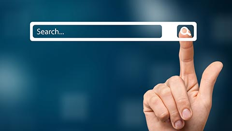 Finger touching a search button
