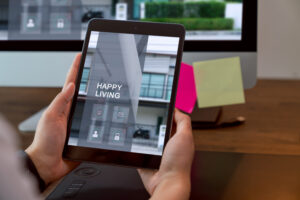 A person holding a tablet interacting with their apartment community digitally to pay rent, schedule amenities, and more.